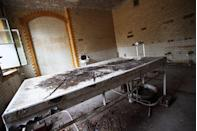 <p>Look closely and you'll notice the blood-soaked stains that permanently haunt this old dissection table.</p>