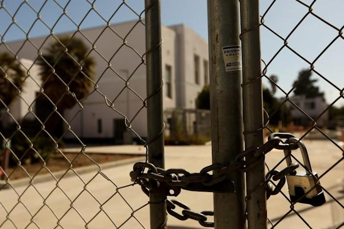"""VENICE, CA - JULY 13, 2020 - - A padlock keeps the campus of Venice High School shuttered in Venice on July 13, 2020. Los Angeles campuses will not reopen for classes on Aug. 18, and the nation's second-largest school system will continue with online learning until further notice, because of the worsening coronavirus surge, Supt. Austin Beutner announced Monday. """"Let me be crystal clear,"""" Beutner said in an interview with The Times. """"We all know the best place for students to learn is in a school setting."""" But, he said, """"We're going in the wrong direction. And as much as we want to be back at schools and have students back at schools - can't do it until it's safe and appropriate."""" (Genaro Molina / Los Angeles Times)"""