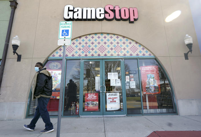 A GameStop storefront is shown before opening Thursday morning, Jan. 28, 2021, in Dallas. The online trading platform Robinhood is moving to restrict trading in GameStop and other stocks that have soared recently due to rabid buying by smaller investors. GameStop stock has rocketed from below $20 to around $350 this month as a volunteer army of investors on social media challenged big institutions who has placed market bets that the stock would fall. (AP Photo/LM Otero)