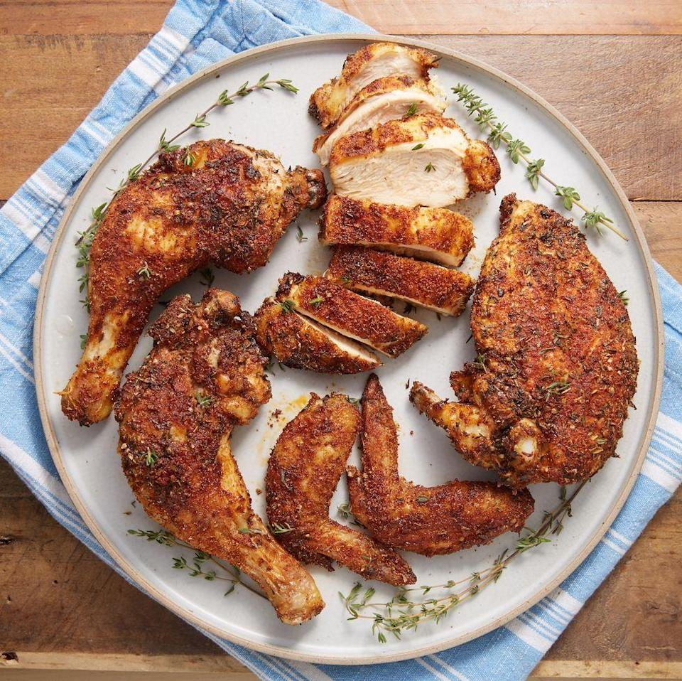 """<p>We love a good <a href=""""https://www.delish.com/uk/cooking/recipes/a28926109/classic-roast-chicken-recipe/"""" rel=""""nofollow noopener"""" target=""""_blank"""" data-ylk=""""slk:Classic Roasted Chicken"""" class=""""link rapid-noclick-resp"""">Classic Roasted Chicken</a>, but it's not always practical for a weeknight dinner. This easy air fryer recipe takes most of the waiting out of roasting a chicken, with remarkably similar results. We found that even when we cooked our chicken well past 73°C, it was still juicy and not at all dry. <a href=""""https://www.delish.com/uk/kitchen-accessories/g31784513/best-air-fryer/"""" rel=""""nofollow noopener"""" target=""""_blank"""" data-ylk=""""slk:Air fryer"""" class=""""link rapid-noclick-resp"""">Air fryer</a>, we love you. </p><p>Get the <a href=""""https://www.delish.com/uk/cooking/recipes/a34367289/air-fryer-rotisserie-chicken/"""" rel=""""nofollow noopener"""" target=""""_blank"""" data-ylk=""""slk:Air Fryer Rotisserie Chicken"""" class=""""link rapid-noclick-resp"""">Air Fryer Rotisserie Chicken</a> recipe.</p>"""