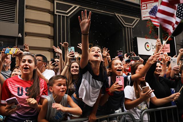 """Young fans cheer as members of the US Women's National Soccer Team travel down the """"Canyon of Heroes"""" in a ticker tape parade on July 10, 2019 in New York City. The team defeated the Netherlands 2-0 Sunday in France to win the 2019 Women's World Cup. (Photo by Spencer Platt/Getty Images)"""