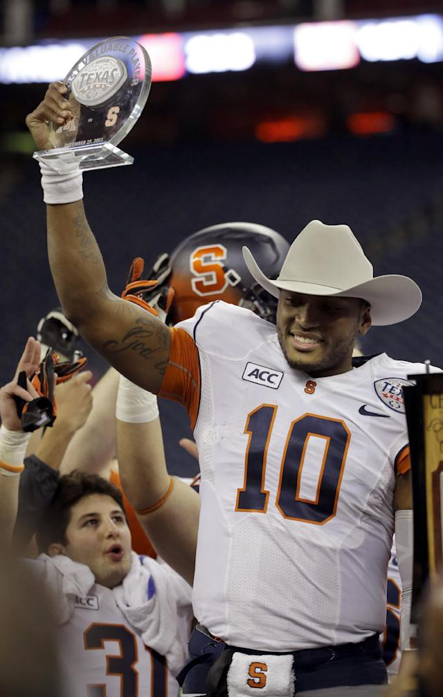 Syracuse quarterback Terrel Hunt (10) holds up his Most Valuable Player trophy after winning the Texas Bowl NCAA college football game against Minnesota, Friday, Dec. 27, 2013, in Houston. Syracuse won 21-17. (AP Photo/David J. Phillip)