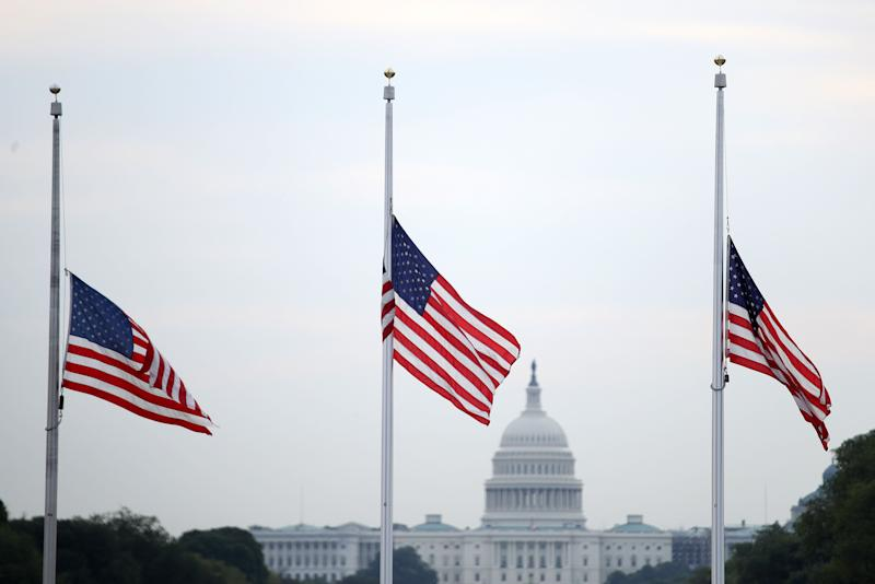 Flags fly at half-staff in Washington after more than 30 people died in mass shootings. (Photo: Win McNamee via Getty Images)