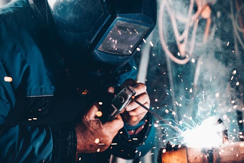 Engineers and blue collar workers are high in demand across the UK right now. Photo: Christopher Burns/Unsplash