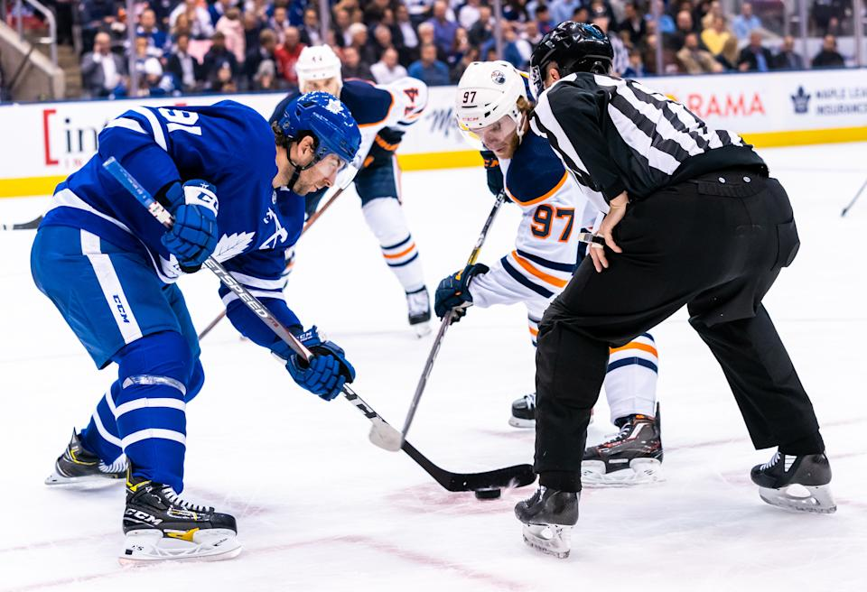 TORONTO, ON - JANUARY 6: John Tavares #91 of the Toronto Maple Leafs takes a face off against Connor McDavid #97 of the Edmonton Oilers during the first period at the Scotiabank Arena on January 6, 2020 in Toronto, Ontario, Canada. (Photo by Kevin Sousa/NHLI via Getty Images)