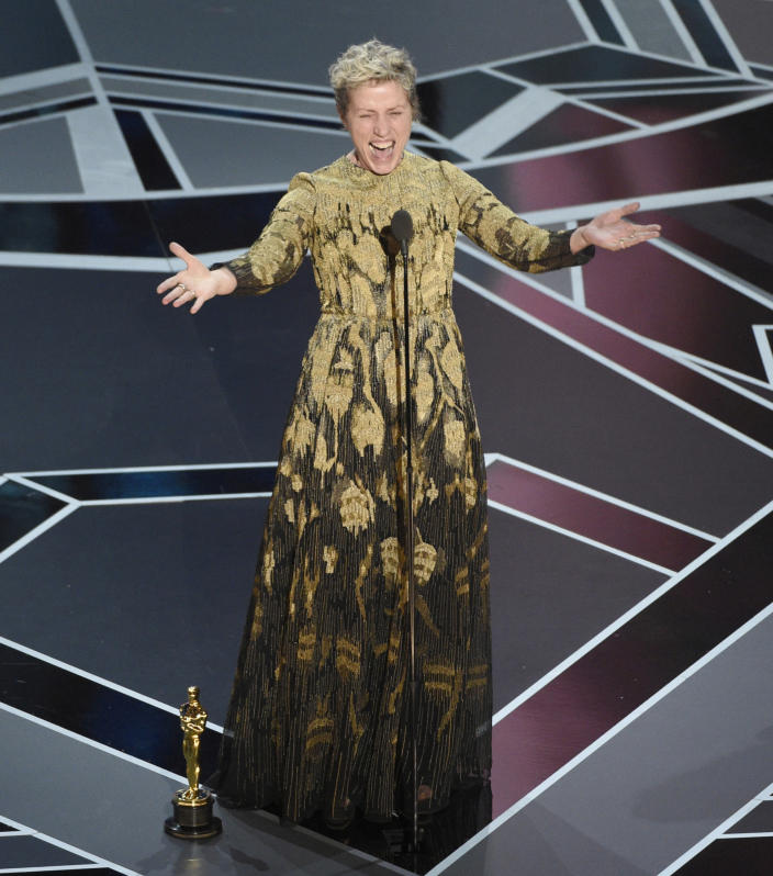 """FILE - In this March 4, 2018 file photo, Frances McDormand accepts the award for best performance by an actress in a leading role for """"Three Billboards Outside Ebbing, Missouri"""" at the Oscars in Los Angeles. McDormand asked all the women nominees in the room to stand, and instructed Hollywood to tell their stories. (Photo by Chris Pizzello/Invision/AP, File)"""