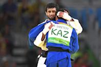 <p>Beslan Mudranov of Russia (white) consoles Yeldos Smetov of Kazakhstan after defeating him in the Men's -60 kg Gold Medal contest on Day 1 of the Rio 2016 Olympic Games at Carioca Arena 2 on August 6, 2016 in Rio de Janeiro, Brazil. (Photo by Laurence Griffiths/Getty Images) </p>