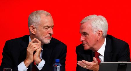 The Labour Party's shadow Chancellor of the Exchequer John McDonnell speaks to party leader Jeremy Corbyn at the party's conference in Liverpool, Britain, September 24, 2018. REUTERS/Phil Noble