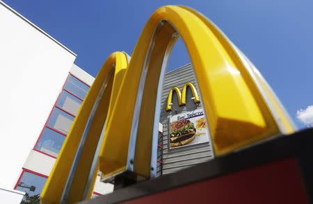 A logo of McDonald's Corp's is on display outside its restaurant on the outskirts of Moscow July 25, 2014. Russia's consumer protection agency has filed a lawsuit in a Moscow court seeking to ban some of McDonald's Corp's burgers along with its milk shakes and ice cream, a court spokeswoman said on July, 25, 2014. REUTERS/Maxim Shemetov