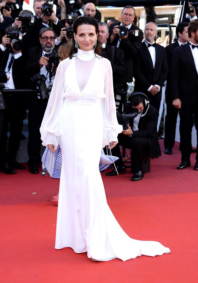 <p>The conservative cut of Juliette Binoche's custom Chloé gown was made all the more sexy with subtle sheer fabric. (Photo: Anthony Harvey/FilmMagic) </p>