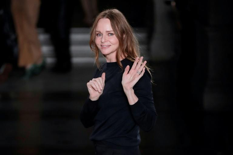 British fashion designer Stella McCartney acknowledges the audience at the end of her women's Fall-Winter 2017-2018 ready-to-wear collection fashion show