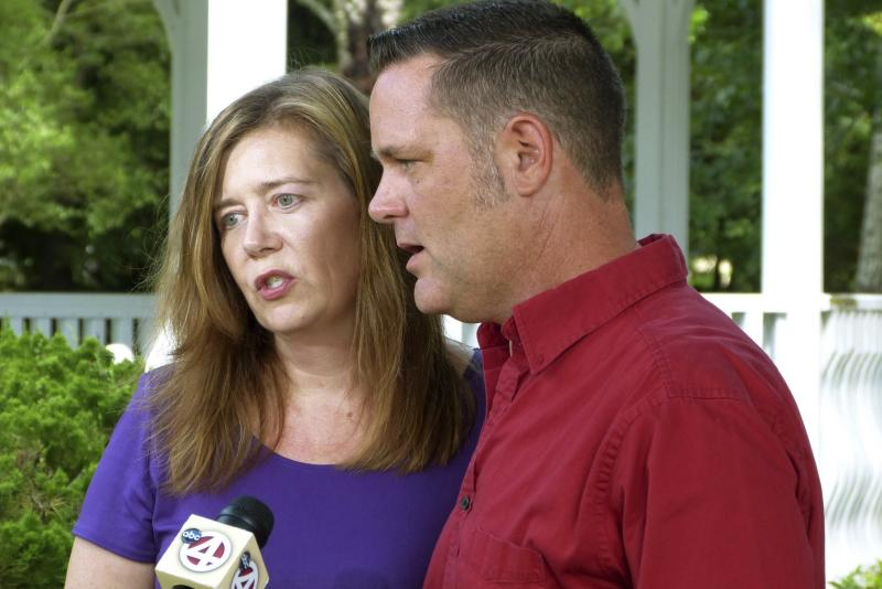 """Melanie and Matt Capobianco talk to reporters in their suburban neighborhood near Charleston, South Carolina in this June 25, 2013, file photo. Another hearing at the Oklahoma Supreme Court is set for later on September 3, 2013, to consider arguments from both sides of the custody dispute betwen Dusten Brown and the adoptive parents, Matt and Melanie Capobianco of South Carolina, over """"Baby Veronica"""". REUTERS/Harriet McLeod/Files (UNITED STATES - Tags: SOCIETY)"""