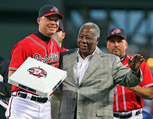 Atlanta Braves Hall of Famer Hank Aaron,right, presents Chipper Jones,left, with third base during his tribute night at Turner Field in Atlanta on Friday, Sept. 28, 2012.  (AP Photo/Atlanta Journal & Constitution, Curtis Compton)