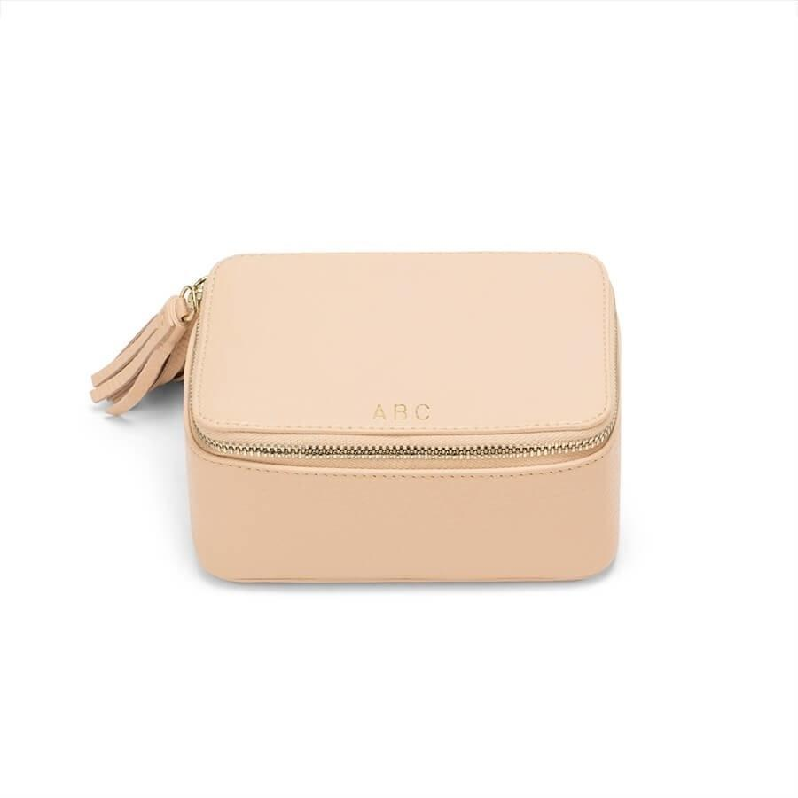 """Made from pebbled Italian leather, this customizable mini jewelry case is as stylish as it is practical. Zip open the tassel to reveal earrings or a necklace (hi, gift number two) inside the felted drawstring pouch, which lets her safely store all her jewelry. $105, Cuyana. <a href=""""https://www.cuyana.com/mini-jewelry-case.html#stone"""" rel=""""nofollow noopener"""" target=""""_blank"""" data-ylk=""""slk:Get it now!"""" class=""""link rapid-noclick-resp"""">Get it now!</a>"""