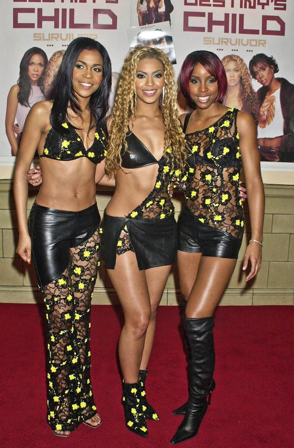 <p>In 2001, wearing coordinated black leather outfits with floral lace accents.</p>