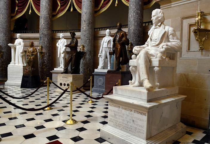 FILE - In this June 24, 2015 file photo, a statue of Alexander Hamilton Stephens, the Confederate vice president throughout the American Civil War, is on display in Statuary Hall on Capitol Hill in Washington. House Minority Leader Nancy Pelosi of Calif is calling for the removal of Confederate statues from the U.S. Capitol as the contentious debate over the appropriateness of such memorials moves to the halls of Congress. (AP Photo/Susan Walsh, File) ORG XMIT: WX104 [Via MerlinFTP Drop]