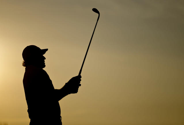 Phil Mickelson watches a shot on the practice tee before a practice round for the U.S. Open golf tournament in Pinehurst, N.C., Tuesday, June 10, 2014. The tournament starts Thursday. (AP Photo/David Goldman)
