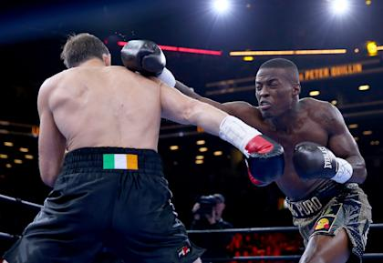 Peter Quillin, right, throws a punch during his draw with Andy Lee in April. (Getty)
