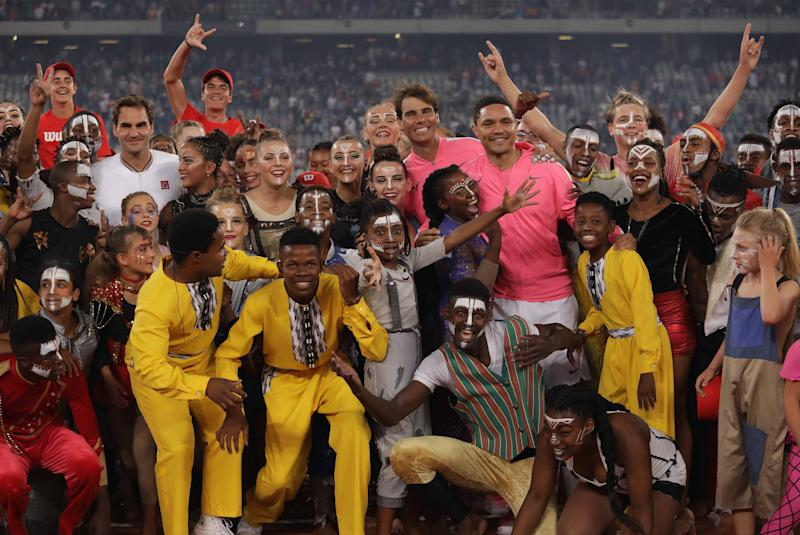 Roger Federer of Switzerland and Rafael Nadal of Spain pose for a photo with children after playing a tennis match at Cape Town Stadium as part of an exhibition game held to support the education of African children, on February 8, 2020 in Cape Town, South Africa. (Photo by Stringer/Anadolu Agency via Getty Images)