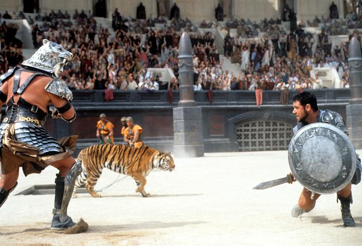 Russell Crowe facing off against tiger in a scene from the film 'Gladiator', 2000. (Photo by Universal/Getty Images)