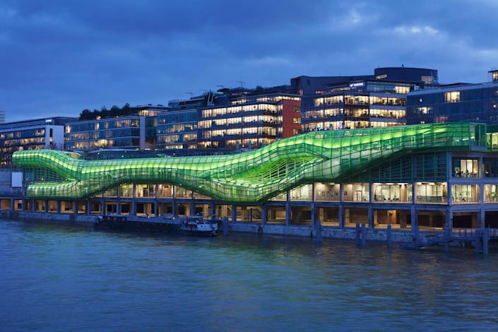 Paris's City of Fashion and Design is located along the banks of the Seine River. Designed by local firm Jakob + MacFarlane, the structure was built within old general stores. What used to be a site that lacked a discernible character is now instantly recognizable by the ultracontemporary, bright-green structure on its exterior.