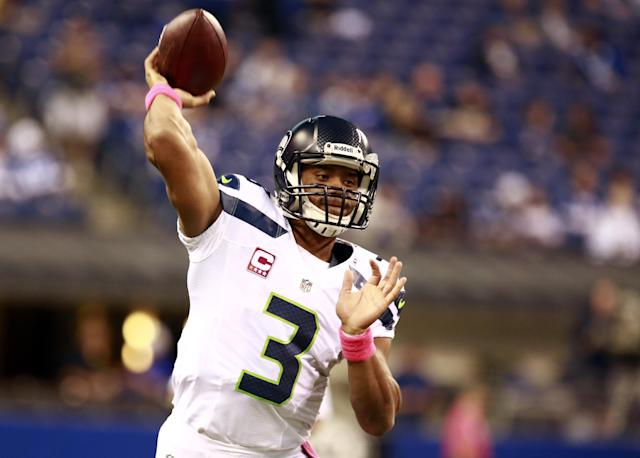 Seattle Seahawks quarterback Russell Wilson throws before an NFL football game against the Indianapolis Colts in Indianapolis, Sunday, Oct. 6, 2013. (AP Photo/Brent R. Smith)