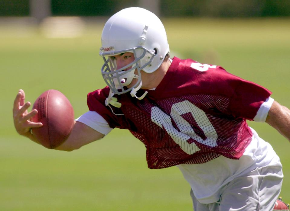 Arizona Cardinals safety Pat Tillman pulls in an interception with one hand during mini camp in Tempe, Ariz. (AP Photo/Paul Connors)