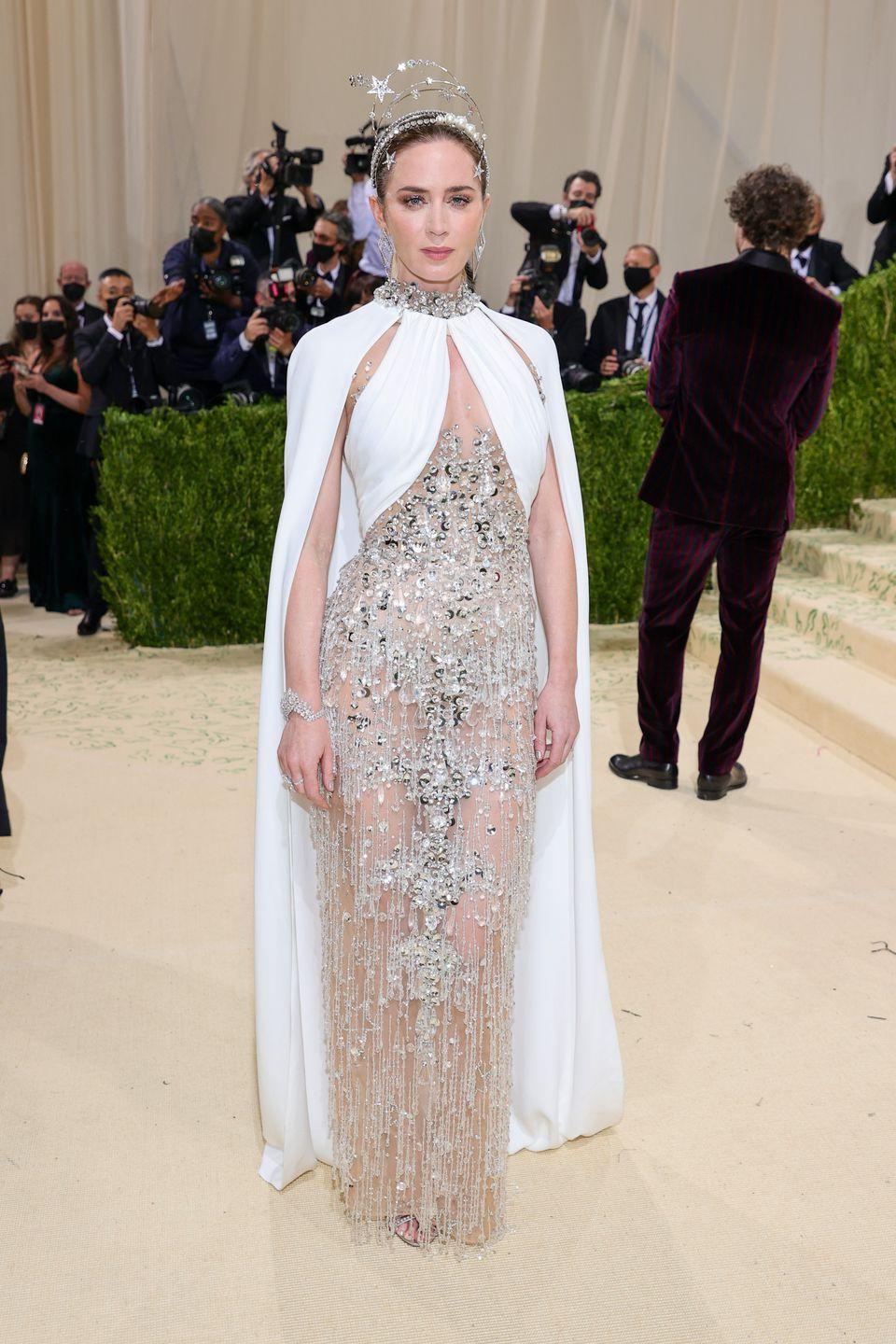 <p>The actor wore an embellished caped gown by Miu Miu.</p>