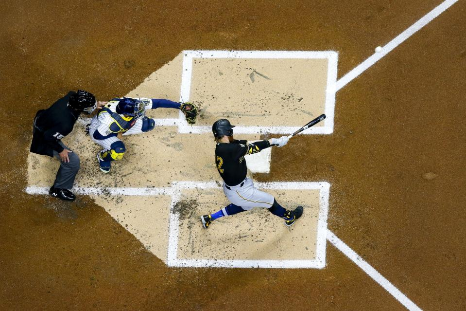 Pittsburgh Pirates' Colin Moran hits a home run during the second inning of a baseball game against the Milwaukee Brewers Friday, April 16, 2021, in Milwaukee. (AP Photo/Morry Gash)