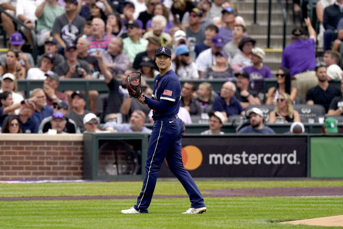 American League's starting pitcher Shohei Ohtani, of the Los Angeles Angeles, watches a fly out during the first inning of the MLB All-Star baseball game, Tuesday, July 13, 2021, in Denver. (AP Photo/Gabriel Christus)
