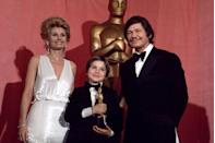 "<p>A then 10-year-old Tatum O'Neal cradled her Best Supporting Actress Oscar backstage while taking photos alongside Jill Ireland and Charles Bronson. She remains the youngest person ever to win an Academy Award (she nabbed it for <em><a href=""https://www.amazon.com/dp/B0035O66BU?ref=sr_1_1_acs_kn_imdb_pa_dp&qid=1547579641&sr=1-1-acs&autoplay=0&tag=syn-yahoo-20&ascsubtag=%5Bartid%7C10055.g.5132%5Bsrc%7Cyahoo-us"" rel=""nofollow noopener"" target=""_blank"" data-ylk=""slk:Paper Moon"" class=""link rapid-noclick-resp"">Paper Moon</a></em>). The telecast was also interrupted by a man running across the stage naked. Oh, the '70s...</p>"