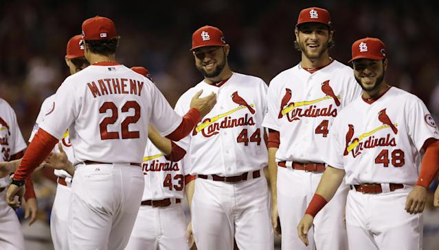 St. Louis Cardinals manager Mike Matheny (22) greets players before the first inning of Game 1 of the National League baseball championship series against the Los Angeles Dodgers, Friday, Oct. 11, 2013, in St. Louis. (AP Photo/Jeff Roberson)