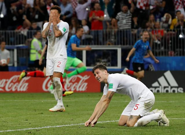 <p>John Stones and Kyle Walker are distraught after Mario Mandzukic gave Croatia an extra time lead </p>