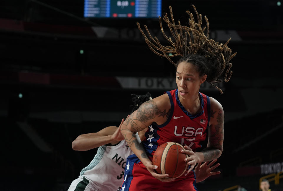 United States' Brittney Griner (15) grabs a rebound during women's basketball preliminary round game against Nigeria at the 2020 Summer Olympics, Tuesday, July 27, 2021, in Saitama, Japan. (AP Photo/Eric Gay)
