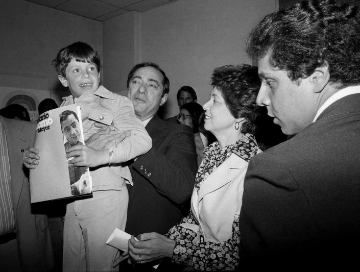 FILE — In this 1977 file photo, New York Secretary of State Mario Cuomo, is shown during a press conference with his family. He holds up his son Christopher, 6, as his wife Matilda, and son Andrew, 19, look on, during his run for mayor of New York City. New York's attorney general has promised a thorough investigation of allegations that Cuomo sexually harassed at least two women. (AP Photo, File)