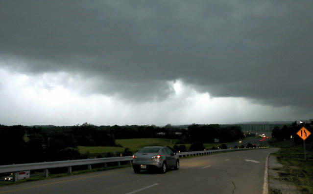 A storm front seen from Chesterfield Parkway westbound onramp to Highway 40 (Interstate 64) is seen looking west in to St. Charles County, in Missouri. The storm rolled into the region Tuesday evening. Funnel clouds were reported in St. Charles County, but there were no immediate reports of major damage. (David Carson/St. Louis Post-Dispatch via AP)