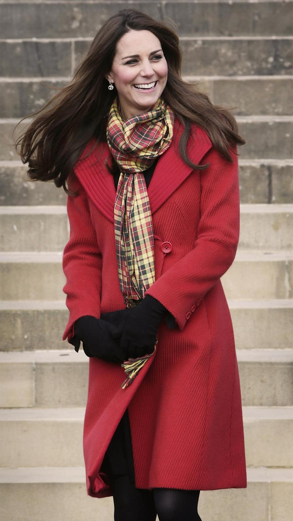 <p>A yellow and red patterned scarf matched Kate's coat during a chilly March 2013 trip to Scotland.</p>