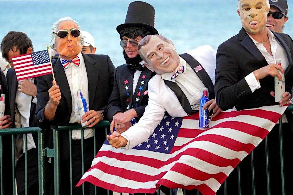 United States fans dressed as presidents cheer on the 15th hole during Day 1 four-ball matches for the 43rd Ryder Cup at Whistling Straits.