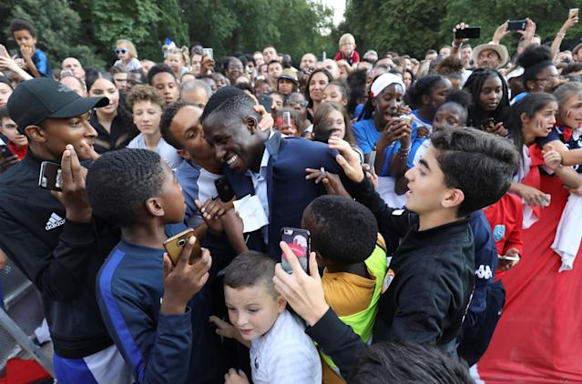 France's defender Benjamin Mendy is congratulated by supporters during a reception at the Elysee Presidential Palace after they won the Russia 2018 World Cup final football match, in Paris, France July 16, 2018. Ludovic Marin/Pool via Reuters