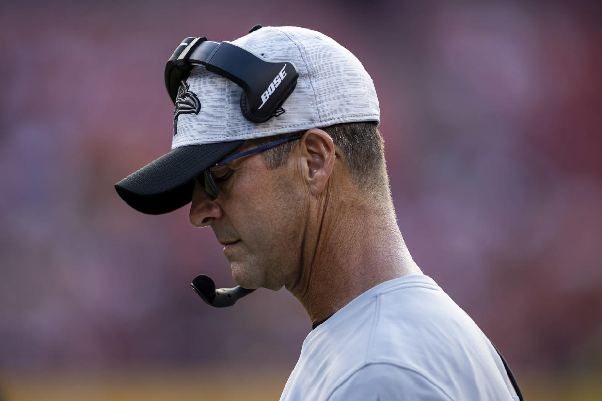 LANDOVER, MD - AUGUST 28: Head coach John Harbaugh of the Baltimore Ravens looks on against the Washington Football Team during the first half of the preseason game at FedExField on August 28, 2021 in Landover, Maryland. (Photo by Scott Taetsch/Getty Images)