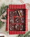 """<p>Make them feel like a million bucks by baking this rich dessert which combines shortbread, caramel and dark chocolate for a taste fit for a fat cat.</p><p><strong><a href=""""https://www.countryliving.com/food-drinks/a34331924/millionaires-shortbread-recipe/"""" rel=""""nofollow noopener"""" target=""""_blank"""" data-ylk=""""slk:Get the recipe"""" class=""""link rapid-noclick-resp"""">Get the recipe</a>.</strong></p><p><a class=""""link rapid-noclick-resp"""" href=""""https://www.amazon.com/Oilproof-Baking-Parchment-Wrapper-Hamburger/dp/B074FWDGKM/ref=sr_1_14?tag=syn-yahoo-20&ascsubtag=%5Bartid%7C10050.g.645%5Bsrc%7Cyahoo-us"""" rel=""""nofollow noopener"""" target=""""_blank"""" data-ylk=""""slk:SHOP PAPER"""">SHOP PAPER</a></p>"""
