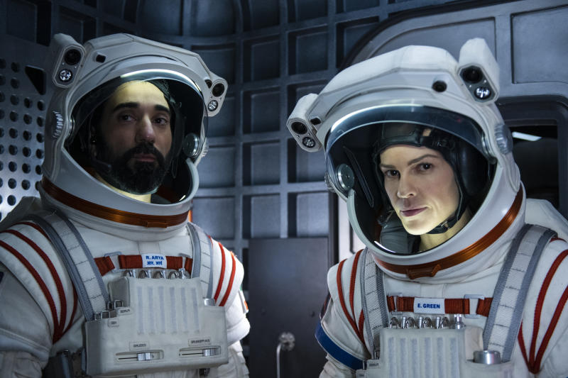 AWAY (L to R) RAY PANTHAKI as RAM ARYA and HILARY SWANK as EMMA GREEN, in episode 109 of AWAY. (DIYAH PERA/NETFLIX © 2020)