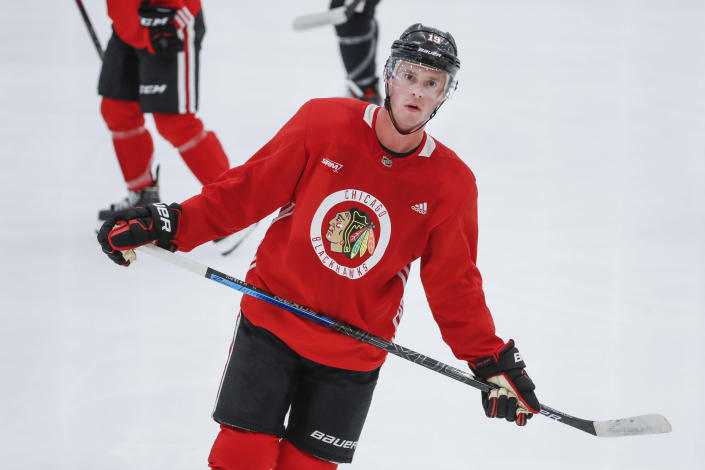 FILE - In this July 13, 2020, file photo, Chicago Blackhawks center Jonathan Toews skates during NHL hockey practice in Chicago. Toews is back after he missed last season while dealing with what he described as chronic immune response syndrome. But the state of the captain's game is a big question mark for his only NHL team. (AP Photo/Kamil Krzaczynski, File)