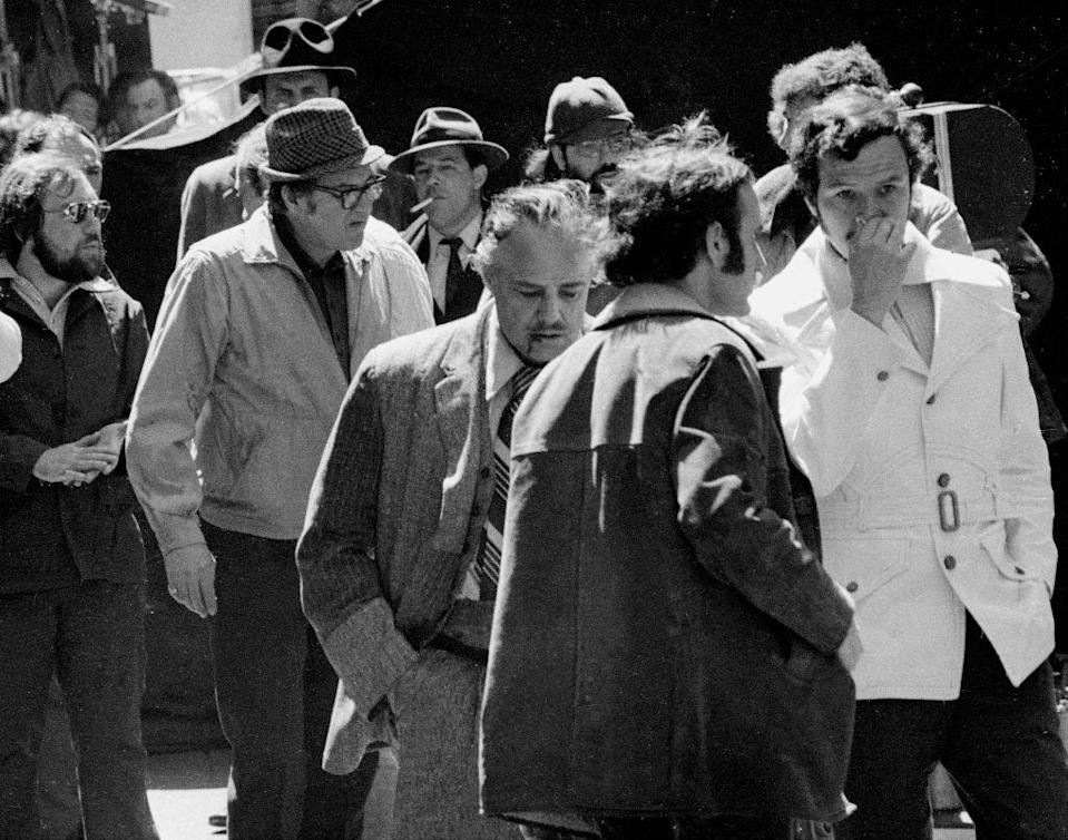 <p>Brando is seen with fake blood on his lip while filming a scene on Mott Street in New York City. </p>