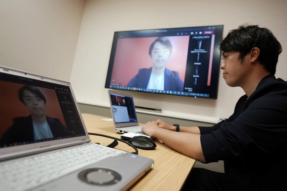 Naruhiko Ito, assistant brand manager of Brand Shiseido Group, demonstrates Shiseido released AR makeup filter for men to use for online meetings in Tokyo Thursday, April 15, 2021. A large personal care company, Shiseido, says one of its male makeup lines has seen double-digit growth during the coronavirus pandemic. Company officials give a similar reason: Men, confronted with the sight of their faces repeatedly during online meetings, want to improve what they see. (AP Photo/Eugene Hoshiko)