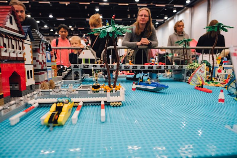 People look at a LEGO creation during the Lego building event in Helsinki, on September 28, 2019. (Photo by Alessandro RAMPAZZO / AFP) (Photo credit should read ALESSANDRO RAMPAZZO/AFP via Getty Images)