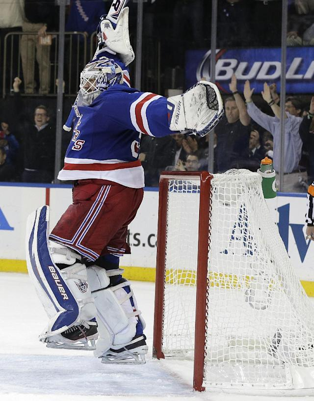New York Rangers goalie Henrik Lundqvist (30) reacts as time winds off the clock to give the New York Rangers a 1-0 win over the Montreal Canadiens in Game 6 of the NHL hockey Stanley Cup playoffs Eastern Conference finals, Thursday, May 29, 2014, in New York. The Rangers advance to the Stanley Cup Finals. (AP Photo/Julie Jacobson)