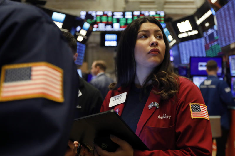 FILE - In this Dec. 13, 2019, file photo trader Ashley Lara works on the floor of the New York Stock Exchange. The U.S. stock market opens at 9:30 a.m. EST on Tuesday, Dec. 24. (AP Photo/Richard Drew, File)