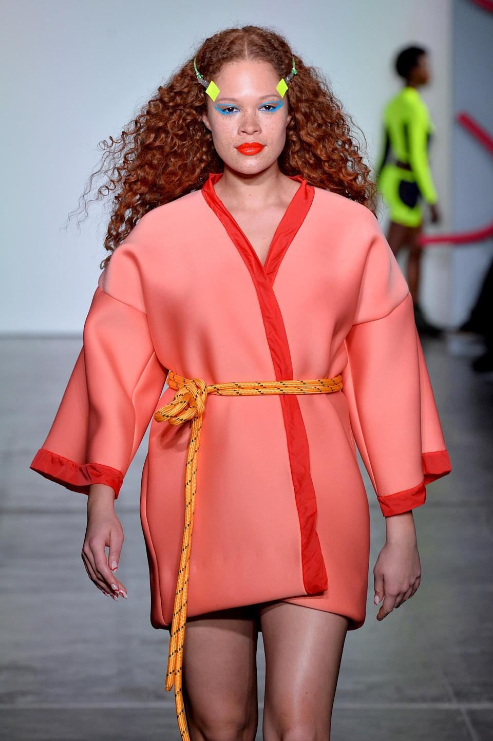 <p>We don't know what we love most: her red hair color or the definition of her waves. (Photo: Getty Images) </p>
