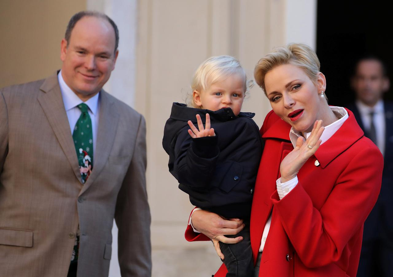 Prince Albert II of Monaco (L), his wife Princess Charlene (R) and their son Prince Jacques attend the traditional Christmas tree ceremony at the Monaco Palace as part of Christmas holiday season in Monaco December 14, 2016.  REUTERS/Eric Gaillard     TPX IMAGES OF THE DAY